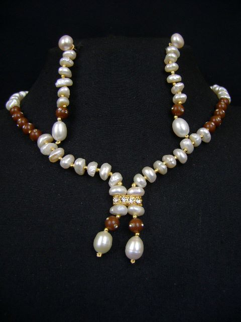 Enchanting Indian Fashion jewelry Pearl Necklace Set at very affordable price